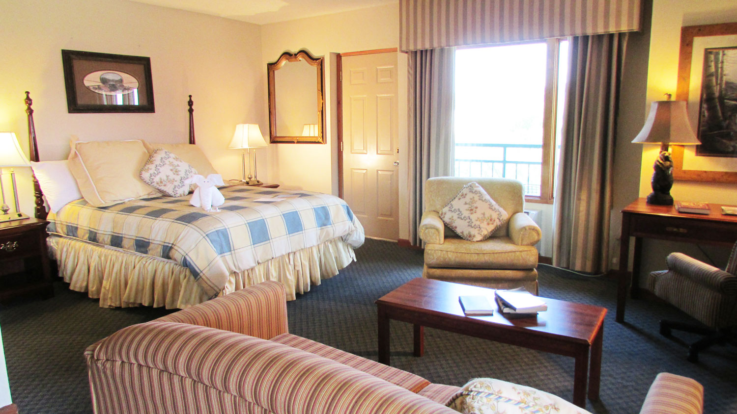 Pigeon Forge Hotel room overlooking the river and meadow - Arbors at Island Landing