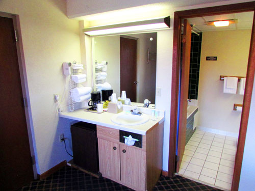 """Vanity and bath in """"Sunday Best"""" River View Balcony Room"""