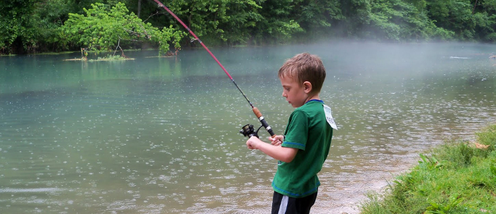 Boy fishing at Pigeon Forge Hotel - Arbors at Island Landing Hotel & Suites