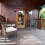 Front Porch - covered with rockers. at Tahlequah Cabin, Arbors Vacation Rentals - Pigeon Forge
