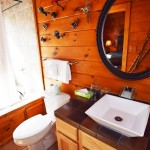 Fishing theme bathroom with rain-fall shower/tub and spaking overlooking the forested vale
