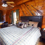 King bedroom with fishing theme at Tahlequah Cabin, Arbors Vacation Rentals - Pigeon Forge