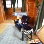 King bedroom with fishing theme and in-room Jacuzzi -  at Tahlequah Cabin, Arbors Vacation Rentals - Pigeon Forge