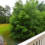 Luxury Condo 2 Bedroom Arbors Vacation Rentals - balcony view over golf course trees